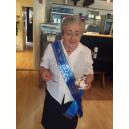 Printed sash on an older woman