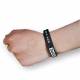 Silicone wristband on the wrist with color filling