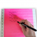 Write with a ballpoint pen on coloured paper wristbands
