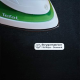 Name label ironed on a black shirt.