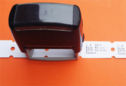 Do-it-yourself rubber stamp for roll tickets